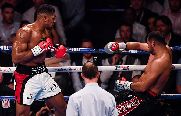 Manchester , United Kingdom - 10 December 2016; Anthony Joshua, left, knocks out Eric Molina during their IBF World Heavyweight Championship fight at the Manchester Arena in Manchester, England. (Photo By Stephen McCarthy/Sportsfile via Getty Images)