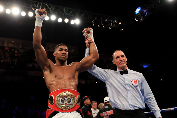 MANCHESTER, ENGLAND - DECEMBER 10: Anthony Joshua of England celebrates his victory over Eric Molina of the United States during their IBF World Heavyweight Championship fight at Manchester Arena on December 10, 2016 in Manchester, England. (Photo by Richard Heathcote/Getty Images)